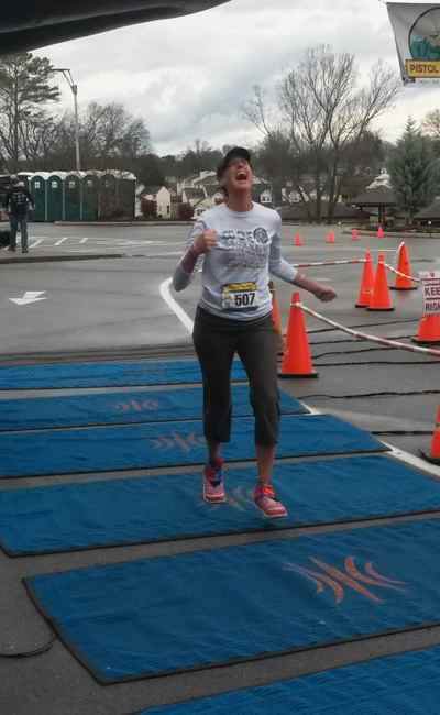 Rachelle Ungerman dances across the finish line at the Pistol Ultra 100 mile race in Alcoa, Tennessee.  (Photo provided)