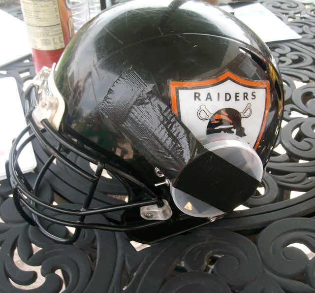 The Safe Tackle Football Helmet teaches players how to tackle with their heads up. Experts say tackling with the head up can reduce the risk of injury. (Photo by Mark Hansel)