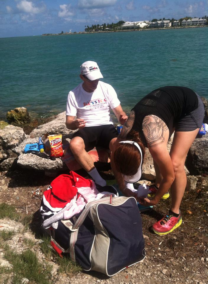 Jim White getting a foot massage and dry clothes from friend and crew member Dianna Petry after his ocean swim. (Photo from Jeff Harmon)