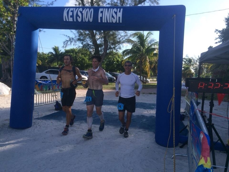 Charles Ray Bell finishing the 100 mile Keys race with two new friends. (Photo provided)