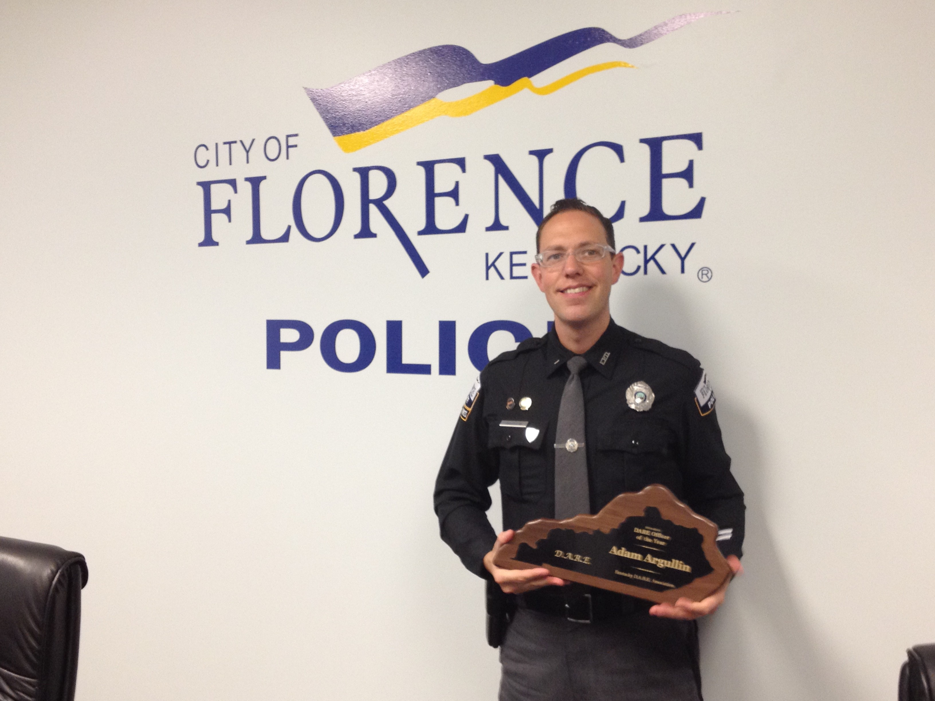 Florence Police Department Community Resource Officer and D.A.R.E. instructor Adam Argullin with his officer of the year award