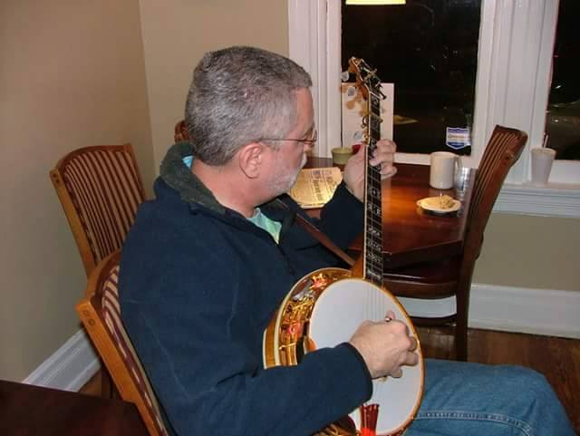 Steve playing banjo at a local coffeehouse.