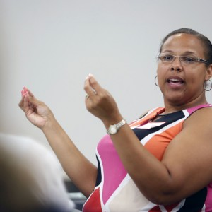 Kenton County middle school math teacher Tenisha Webb shares a problem solving strategy during the Math Teachers' Circle at Northern Kentucky University. (Photo by Amy Wallot)
