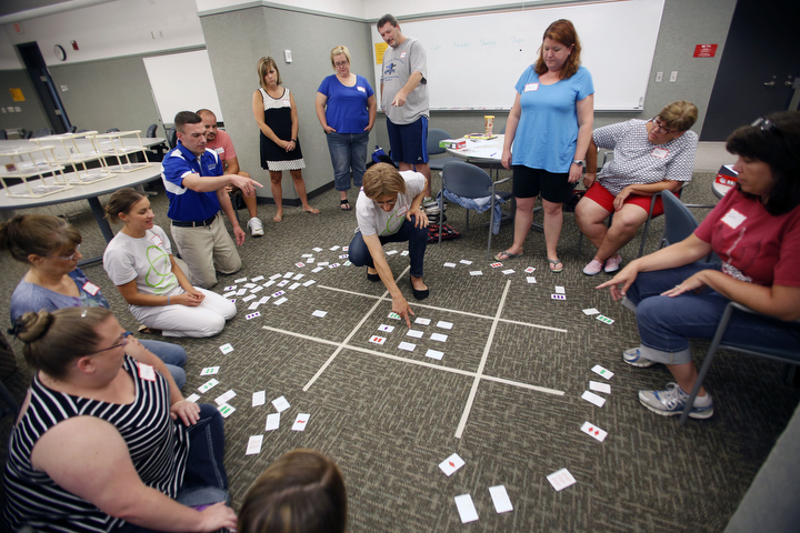 Teachers work together creating a giant board with the card game Set during the Math Teachers' Circle at Northern Kentucky University. (Photo by Amy Wallot)