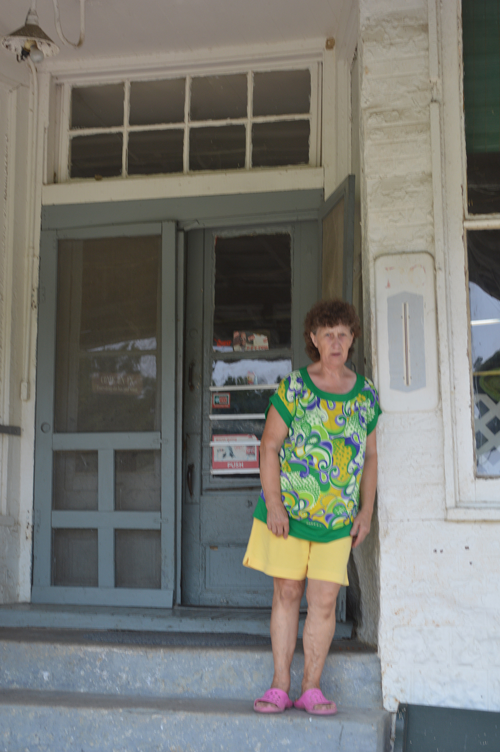 Carolyn Jones on steps of Jones Grocery