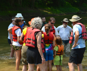 Monte McGregor (center in sunglasses) identifying mussel shells for members of a Sierra Club-sponsored canoe trip along the Licking River (Photo by Andy Mead)