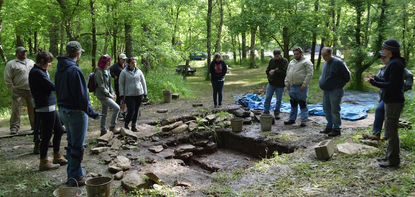 Student and faculty at the site.  (Photo by Eric Goetz)