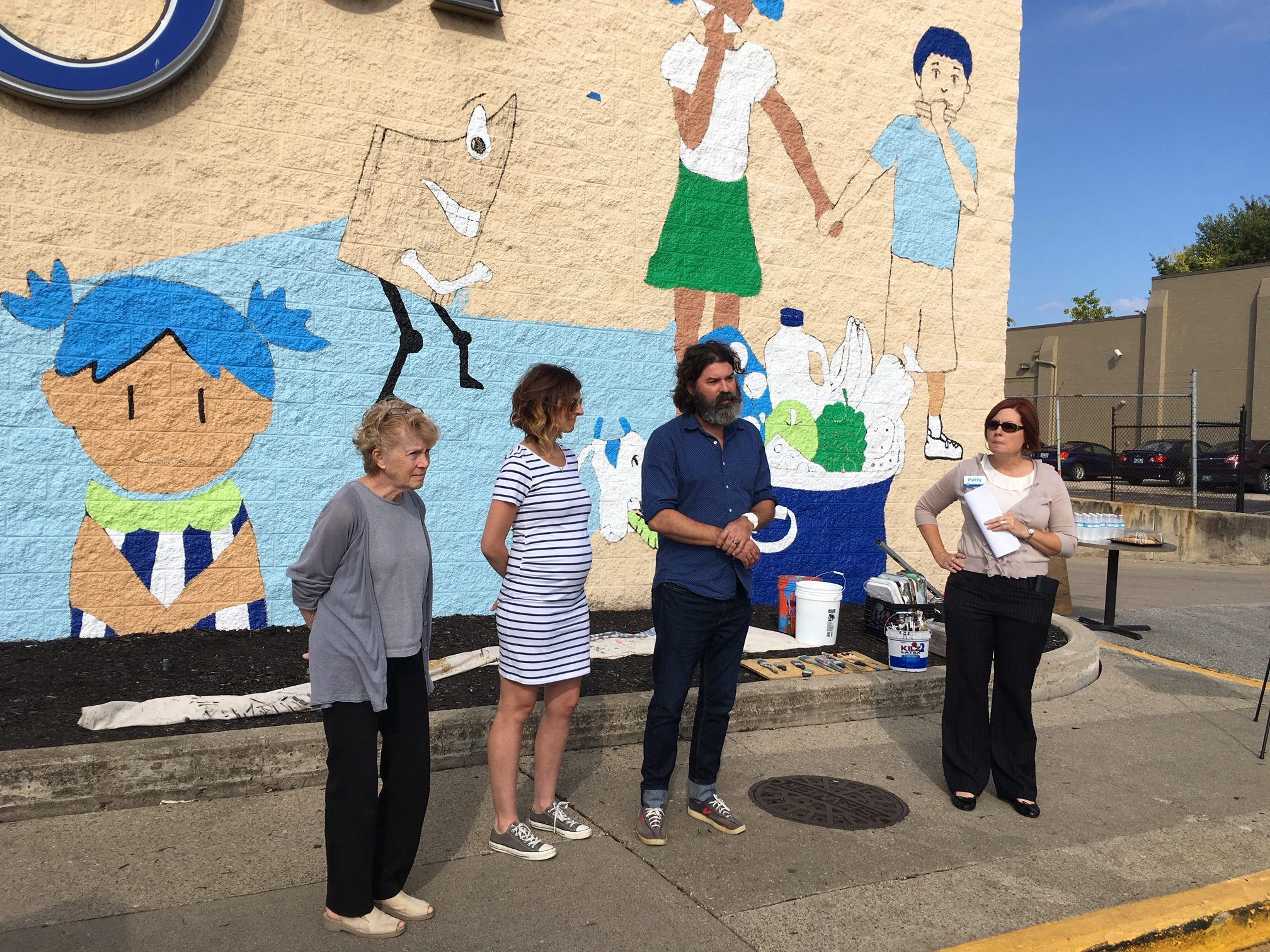Left to right: Covington Mayor Sherry Carran, joins Lesley Amman and Jarrod Becker of BLDG, and Patty Leeseman of Kroger at Thursday's introduction of the mural.