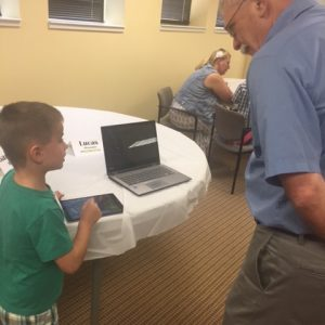 Five-year-old Lucas Meyer demonstrates Footsteps2Brilliance for grandfather Joe Meyer's edification.
