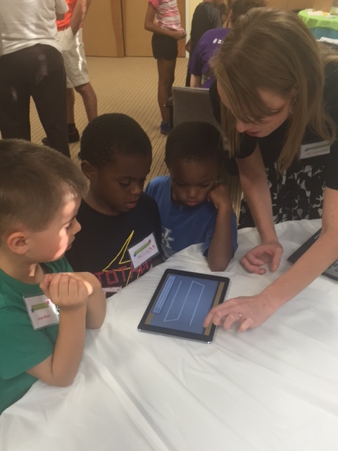 Latonia Elementary kindergarten teacher, Katy Goodridge, with, from left to right, Lucas Meyer, Hassan Dukes, and Hezeikah Dukes on the Footsteps2Brilliance app being used in Covington Independent Schools.