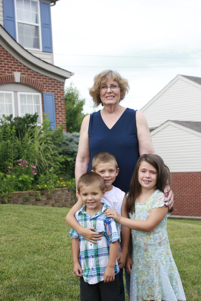 Jeanne Miller-Jacobs with her grandchildren, Jordan, Lieum, and Kelsey.