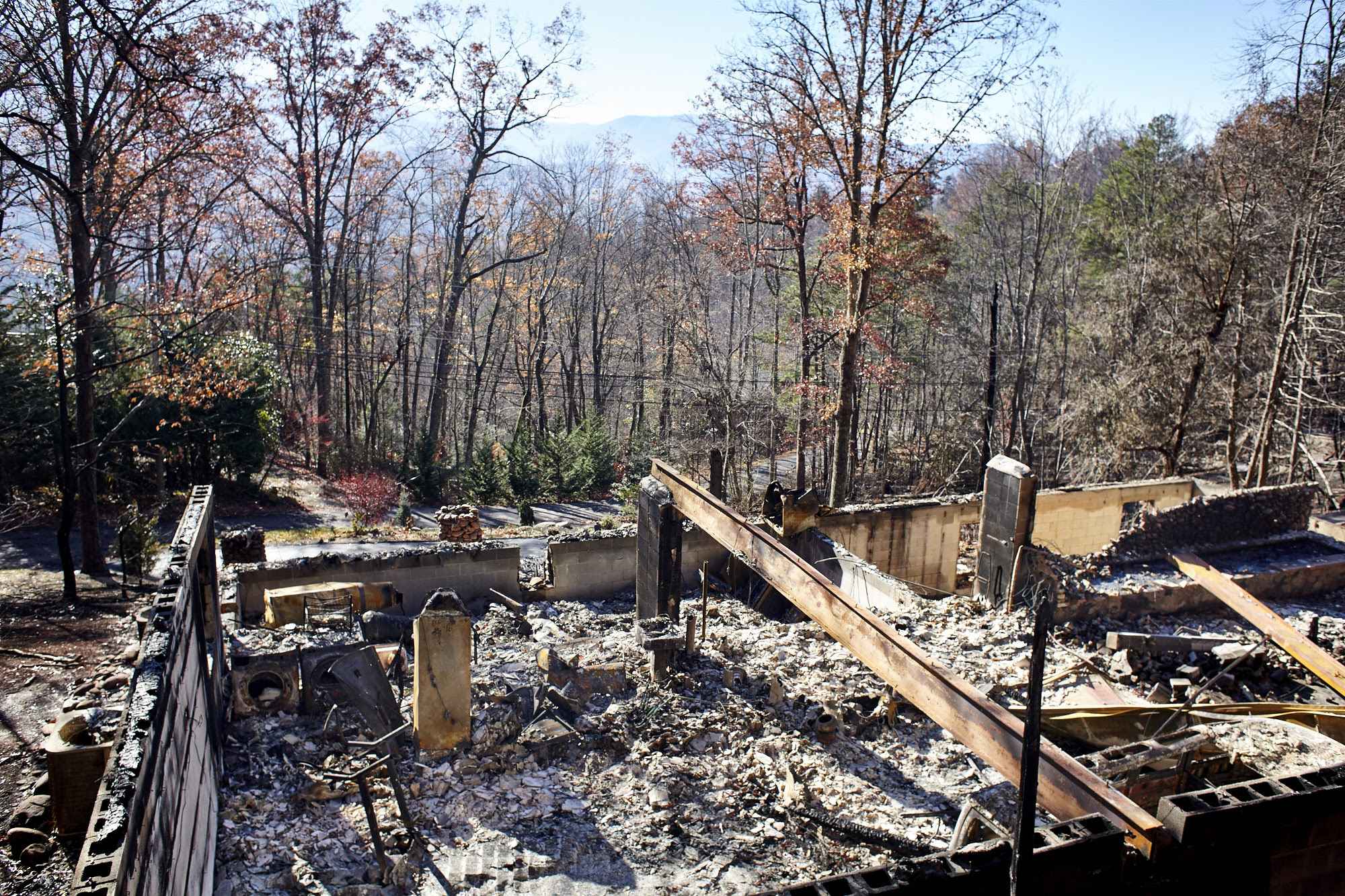 Wildfires have ravaged the hills and homes around Gatlinburg, TN. This site, on a ridge south of town, lost a home. (Photo by Shawn Poynter)