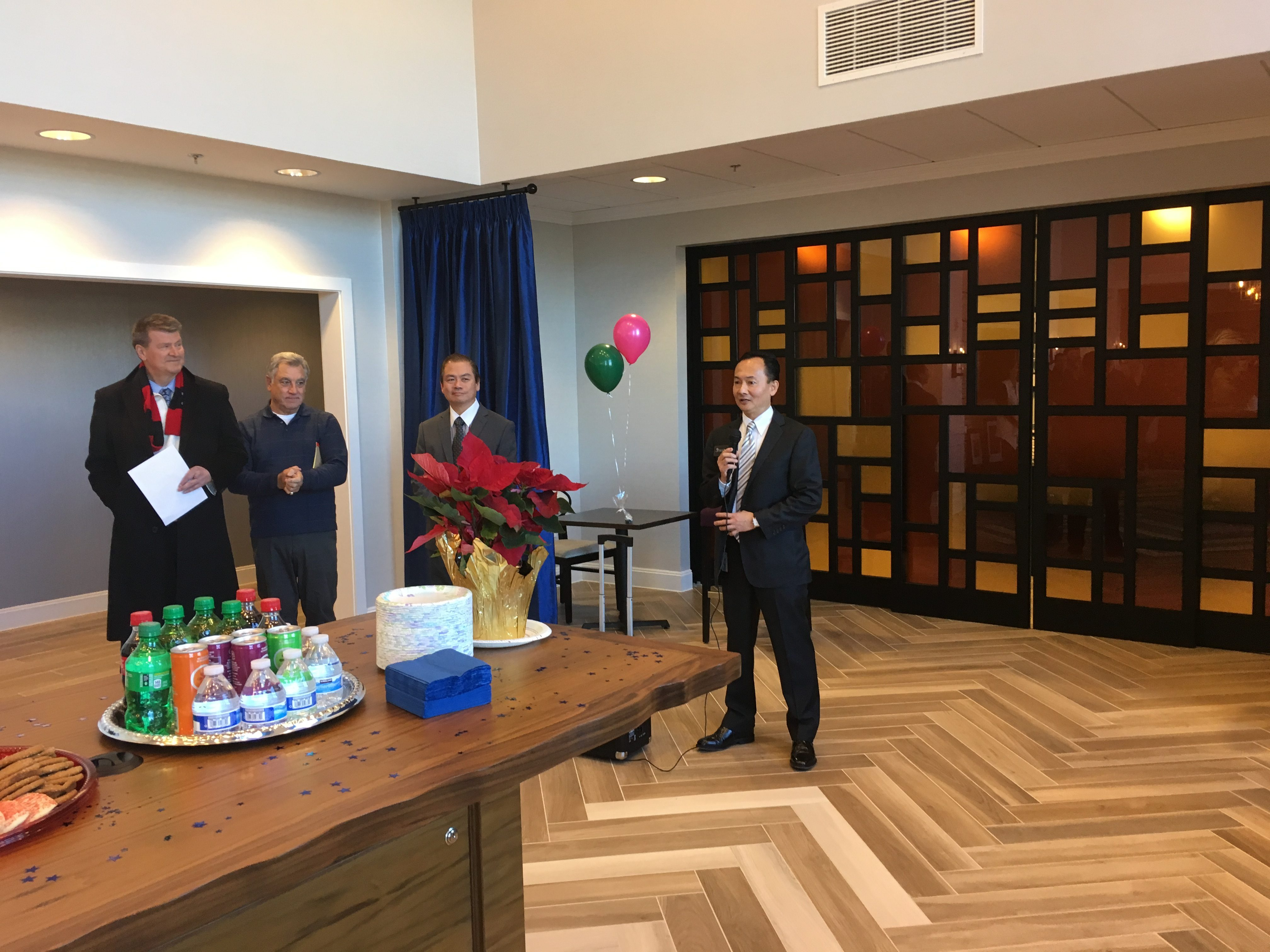 Hampton Inn & Suites by Hilton Newport Cincinnati owner Shaun Pan welcomes guests at Thursday's ribbon cutting (photos by Mark Hansel).