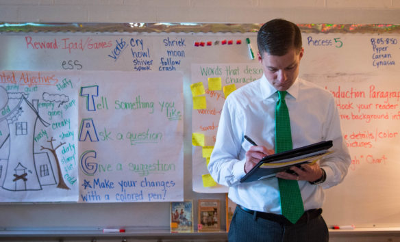 Eric Ball, tassistant principal at Collins Elementary (Boone County) takes notes during a visit to Grandview Elementary (Bellevue Independent).  (Photo by Bobby Ellis)