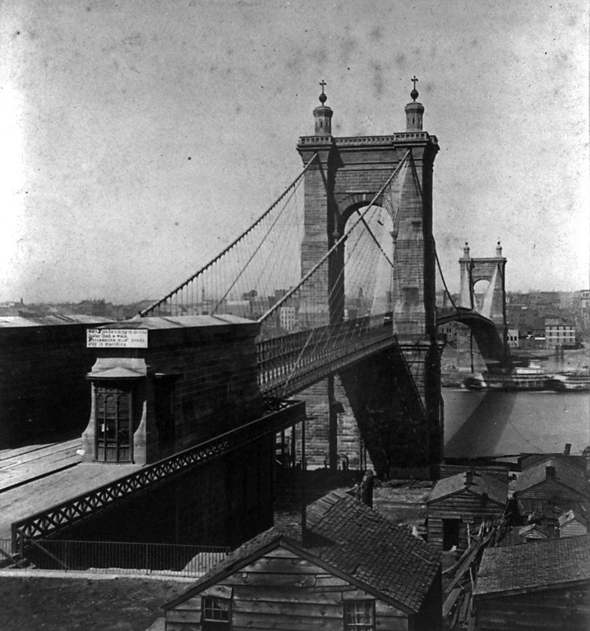 View of the bridge from the Covington side in 1868 with its toll booth. Tolls were still being collected as late as 1963. Library of Congress.