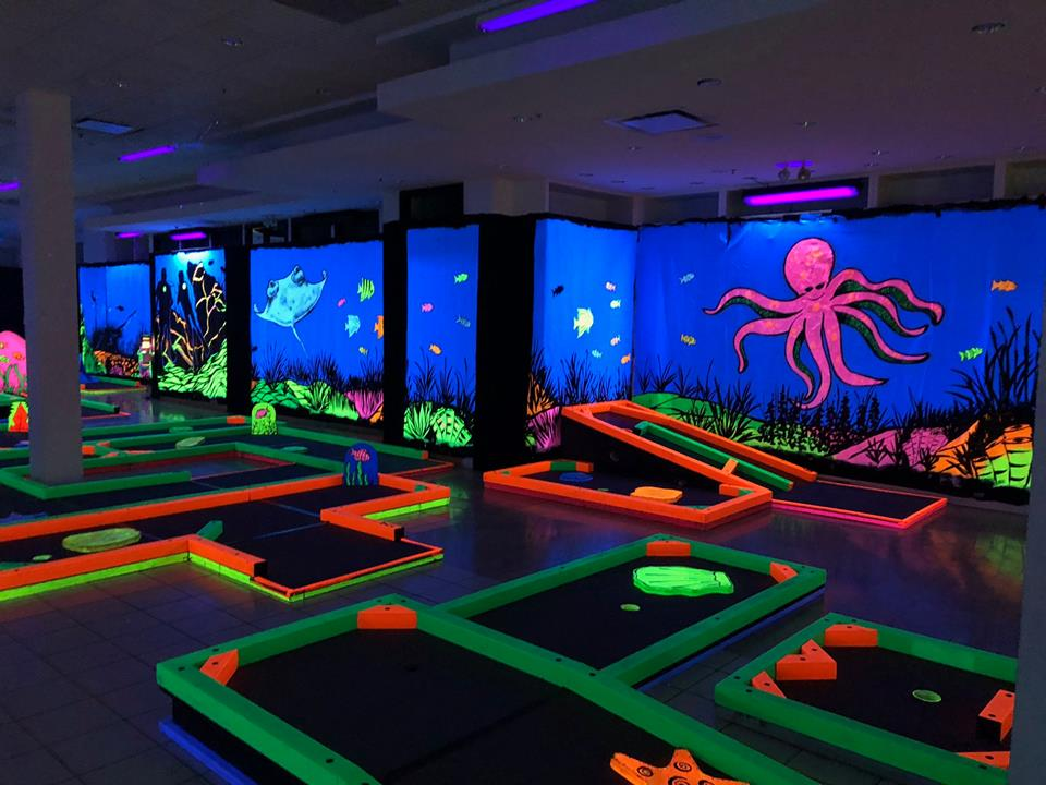 Florence news and notes glowgolf comes to florence mall city hosts special florescent golf balls putters course obstacles and wall dcor all glow under black lights mozeypictures Gallery