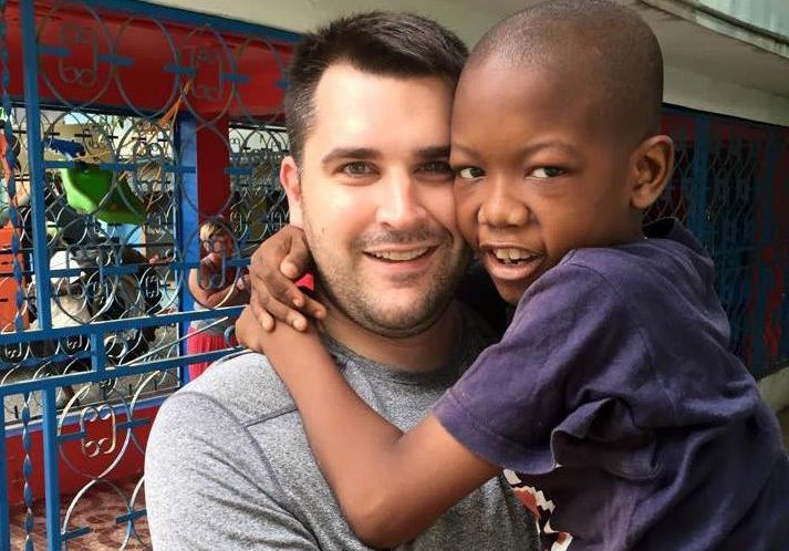 Dave Wickstrom, with a Haitian child he met on a service trip, would like to arrange a similar trip to Haiti for people with disabilities so that 'they can get the same satisfaction of serving in a foreign country as I do.' (Photos provided)