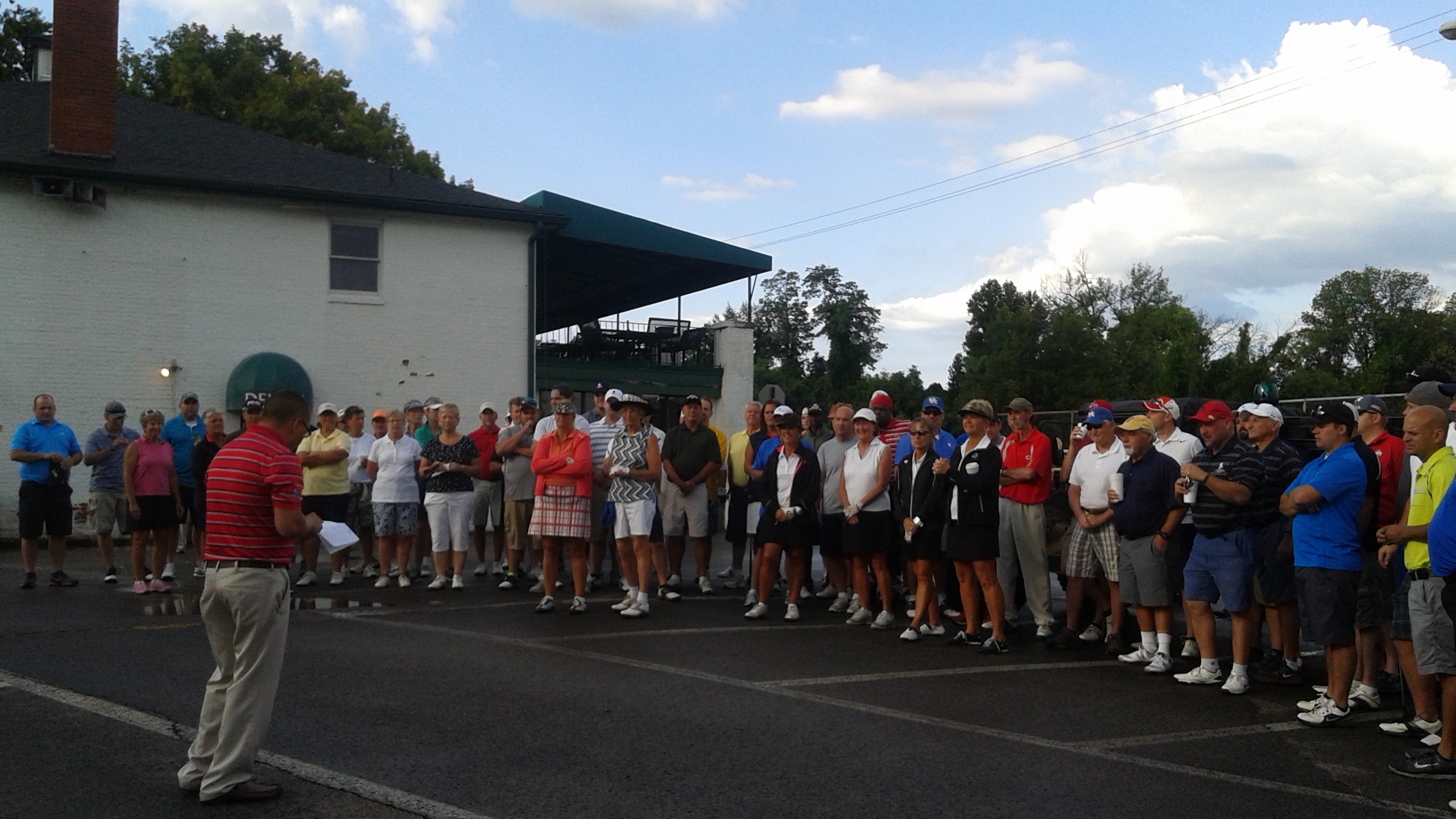 Participants listen to event instructions from Dave Peru  before embarking on this morning's Wounded Warrior fundraising event at Devou Park's golf course. (Photo by Mike Rutledge)