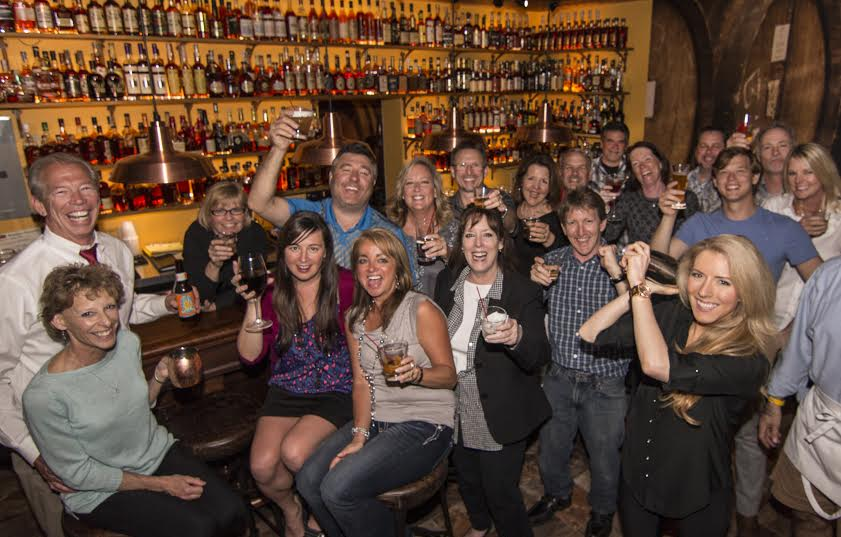 Kim Newberry (behind bar) with patrons of the Prohibition Bourbon Bar in Newport (provided photo).