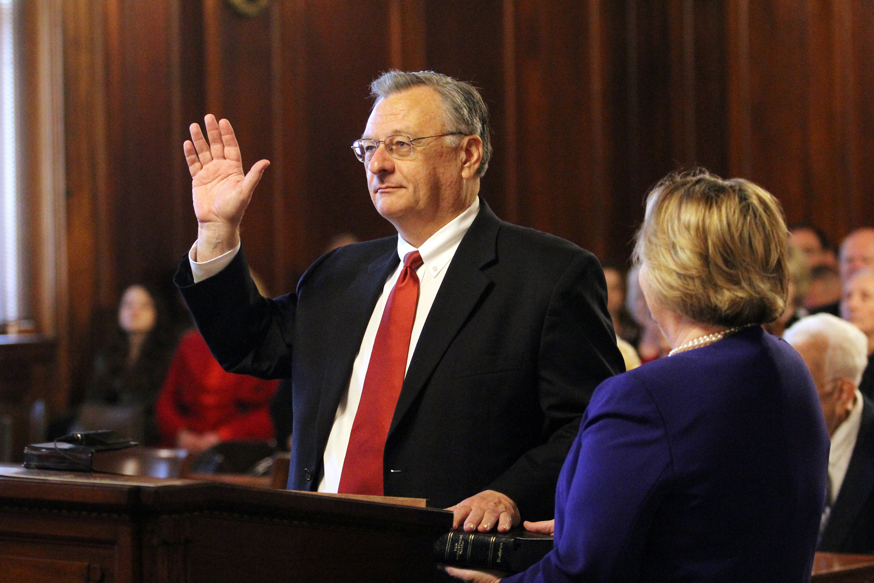 Justice Wright's wife, Jennifer, holds the Bible as he is sworn in by Chief Justice John D. Minton Jr. (Photo provided)