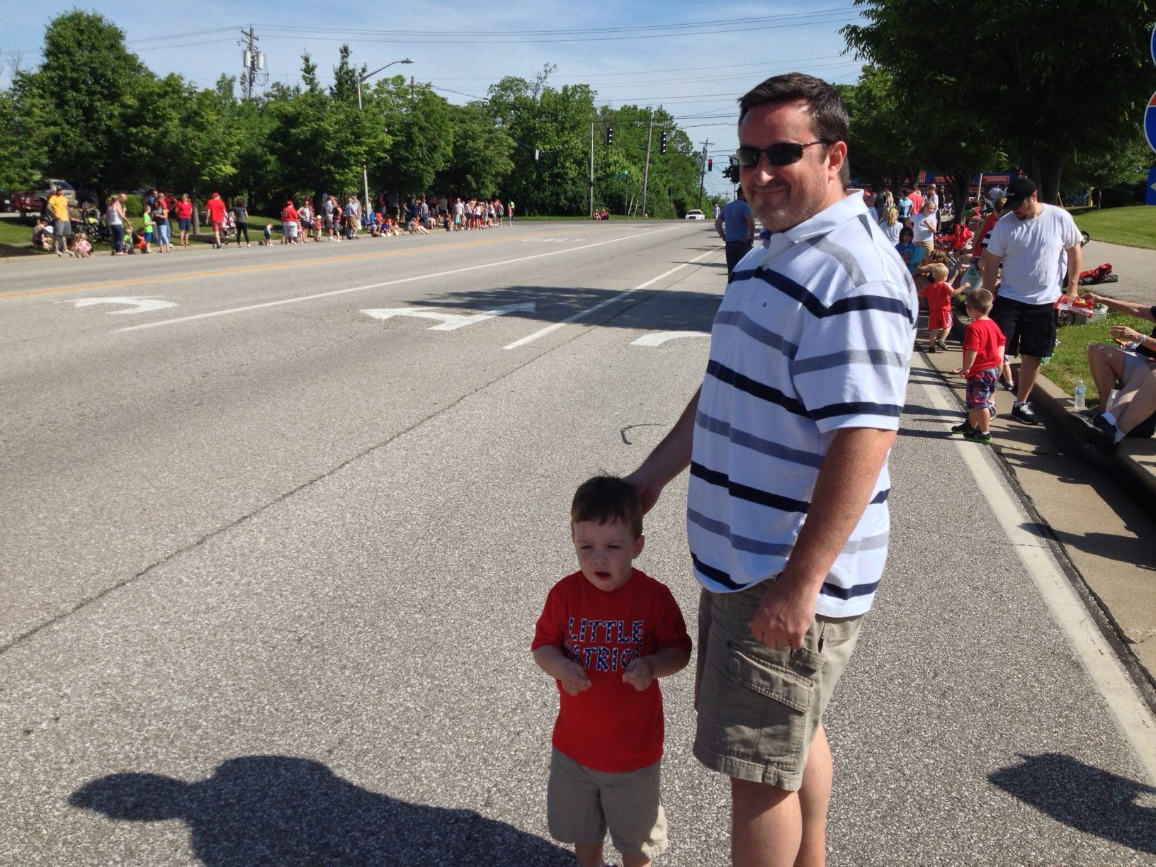 Chris Kennedy of Burlington and his son, Luke, enjoy their first Florence Memorial day Parade.