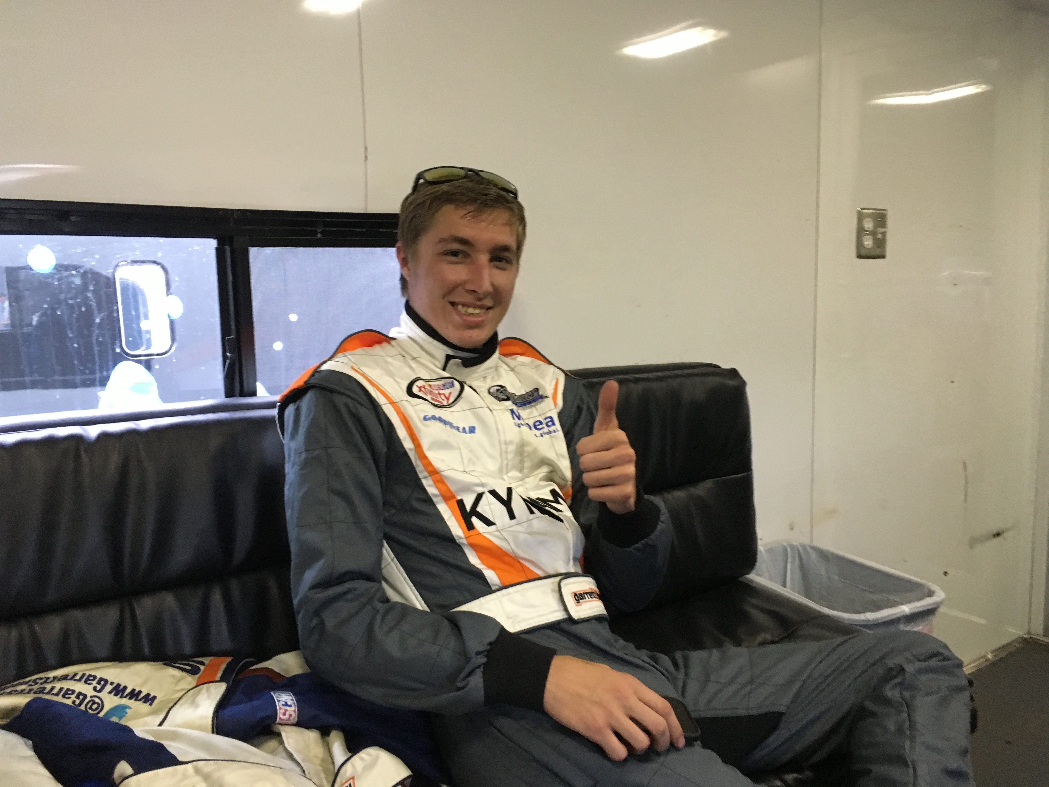 NASCAR XFINITY Series driver Garrett Smithley in his trailer before a weekend race at Kentucky Speedway. Smithley aslo drove in the NCWTS race Thursday, thanks to a sponsorship from Mubea and KY Fame (photo by Mark Hansel).