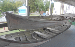 "The granddaddy of all the small wooden boats in the collection is the eighteen-foot Thompson Skiff, built in the 1880's, and another ""under the porch"" boat. The ""scantlings,"" or dimensions of the Thompson, were measured and drawn to scale some years ago by the late Jim Stevens, an associate of the museum."